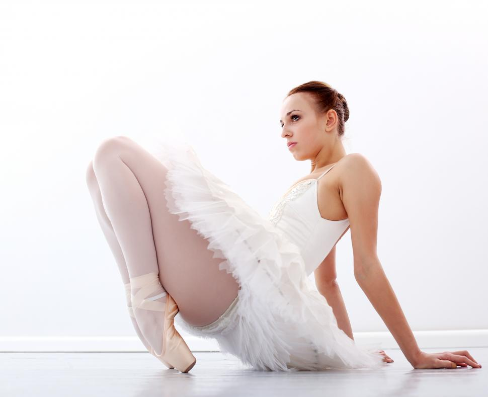 Download Free Stock HD Photo of Beautiful and gorgeous ballerina sitting on the floor Online