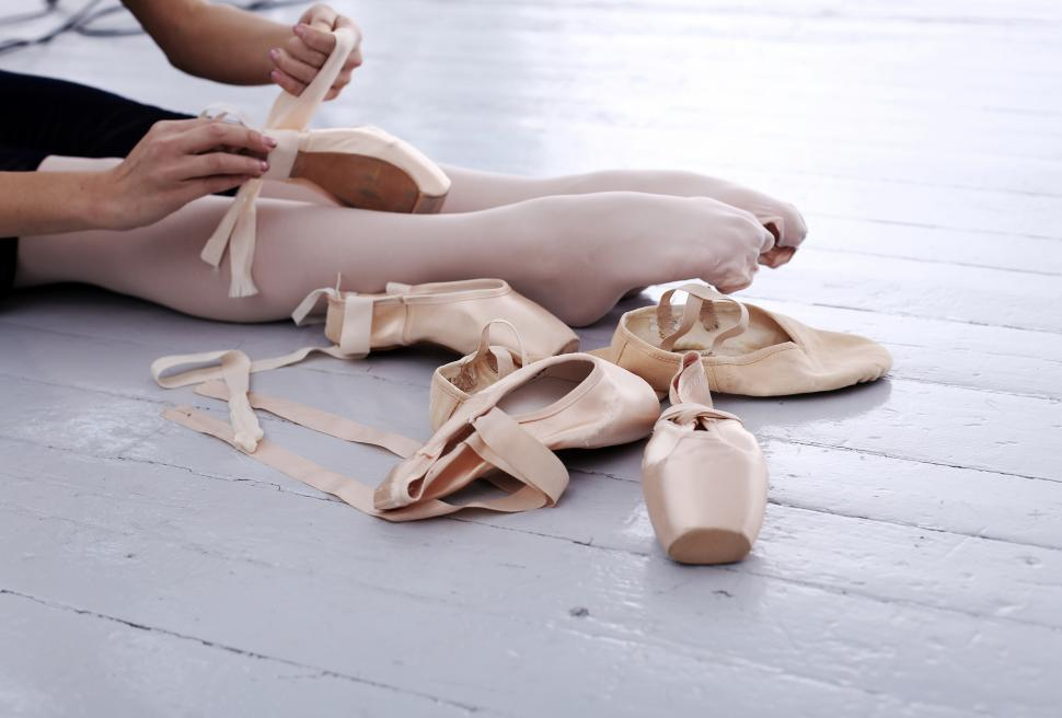 Download Free Stock HD Photo of Photo of beautiful ballerina feet and pointe shoes during preparation Online