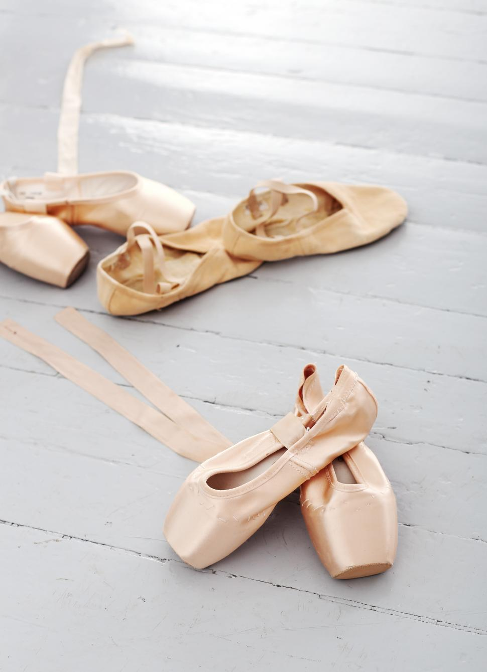 Download Free Stock HD Photo of Ballet shoes lay alone on the floor Online
