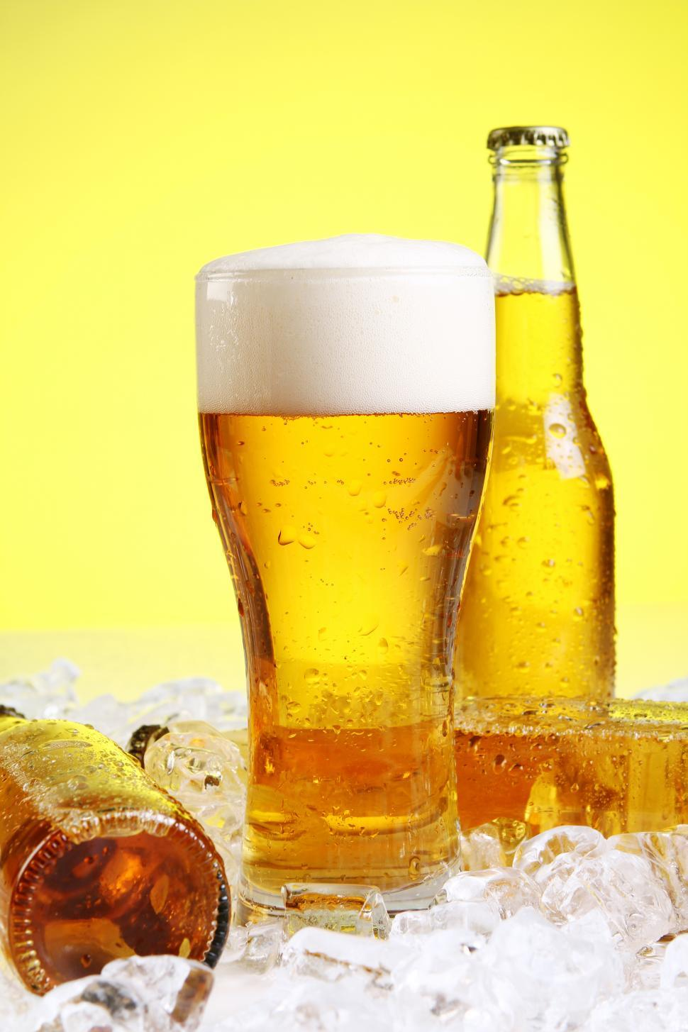 Download Free Stock HD Photo of Glass of beer with foam on yellow background Online