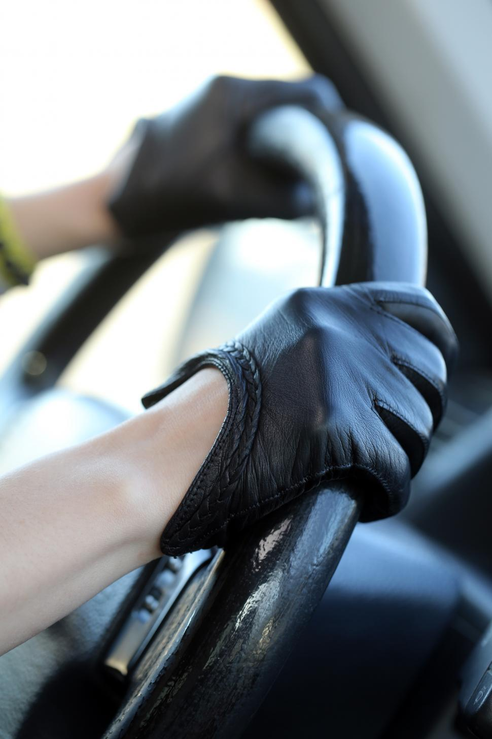 Download Free Stock HD Photo of Racer in leather gloves gripping steering wheel Online