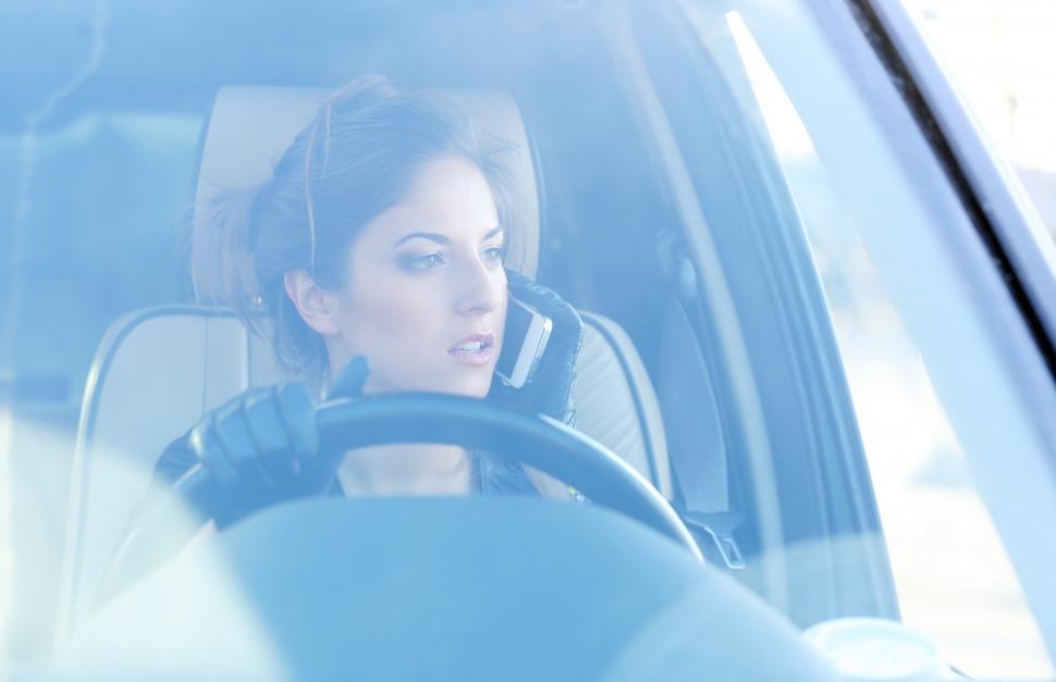 Download Free Stock HD Photo of Cool girl seen through windshield of car Online