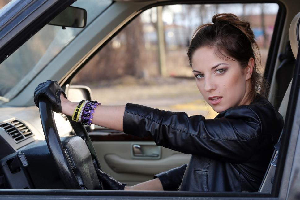 Download Free Stock Photo of Cool girl driving in the car