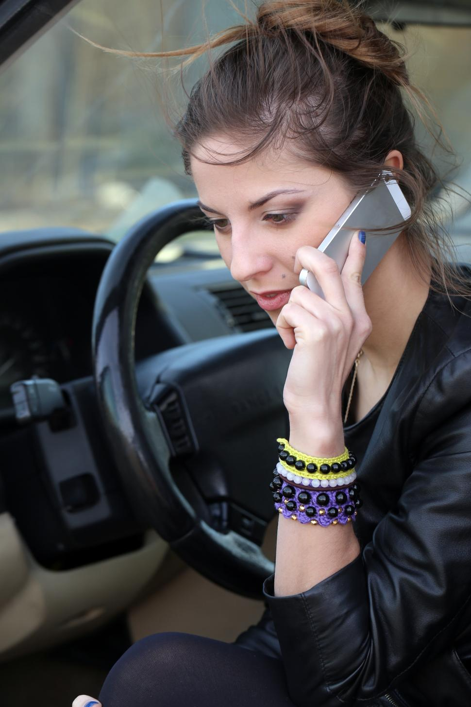 Download Free Stock HD Photo of Attractive woman in the car on the phone Online