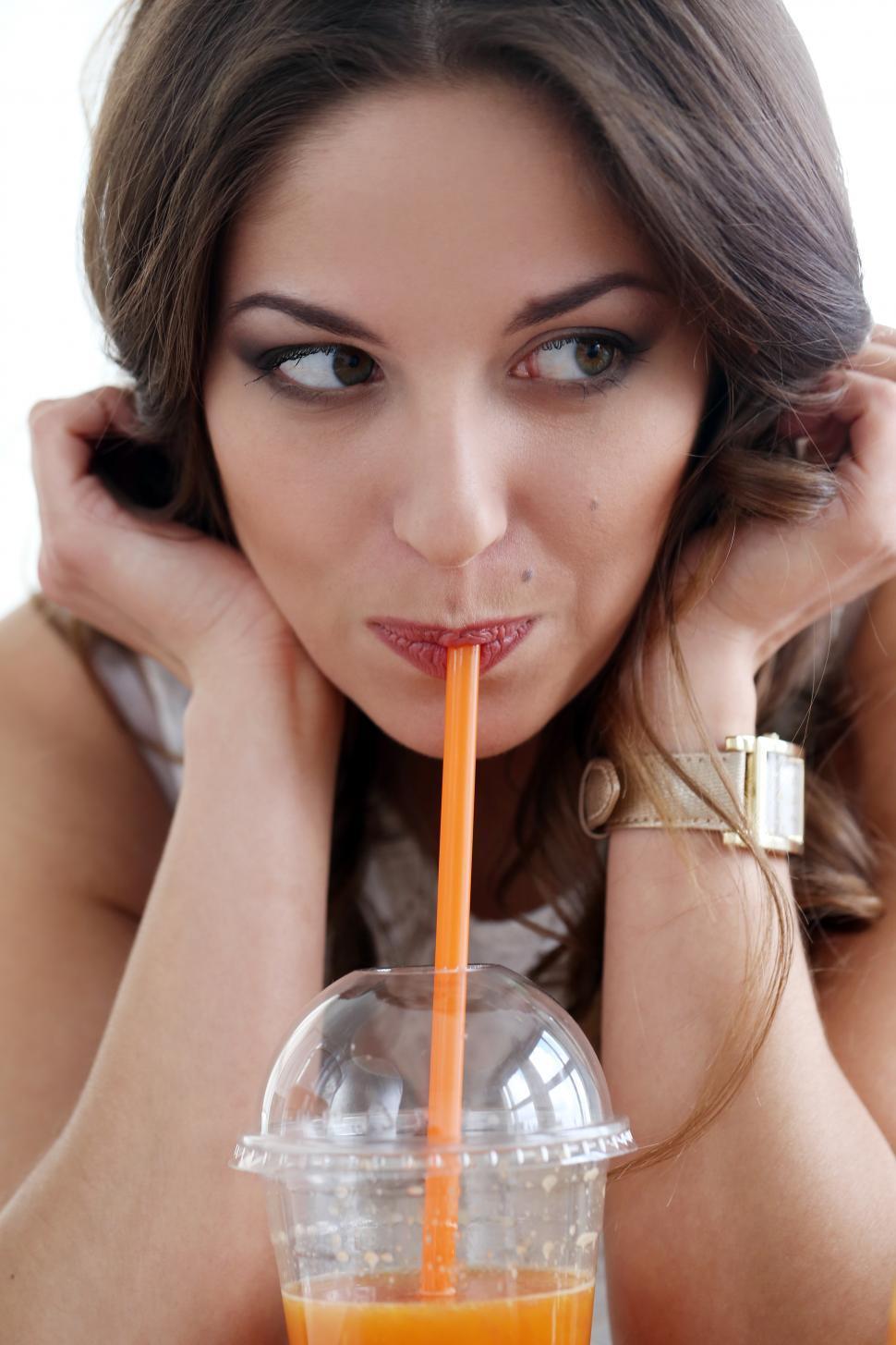 Download Free Stock HD Photo of Beautiful girl drinking fresh orange juice Online