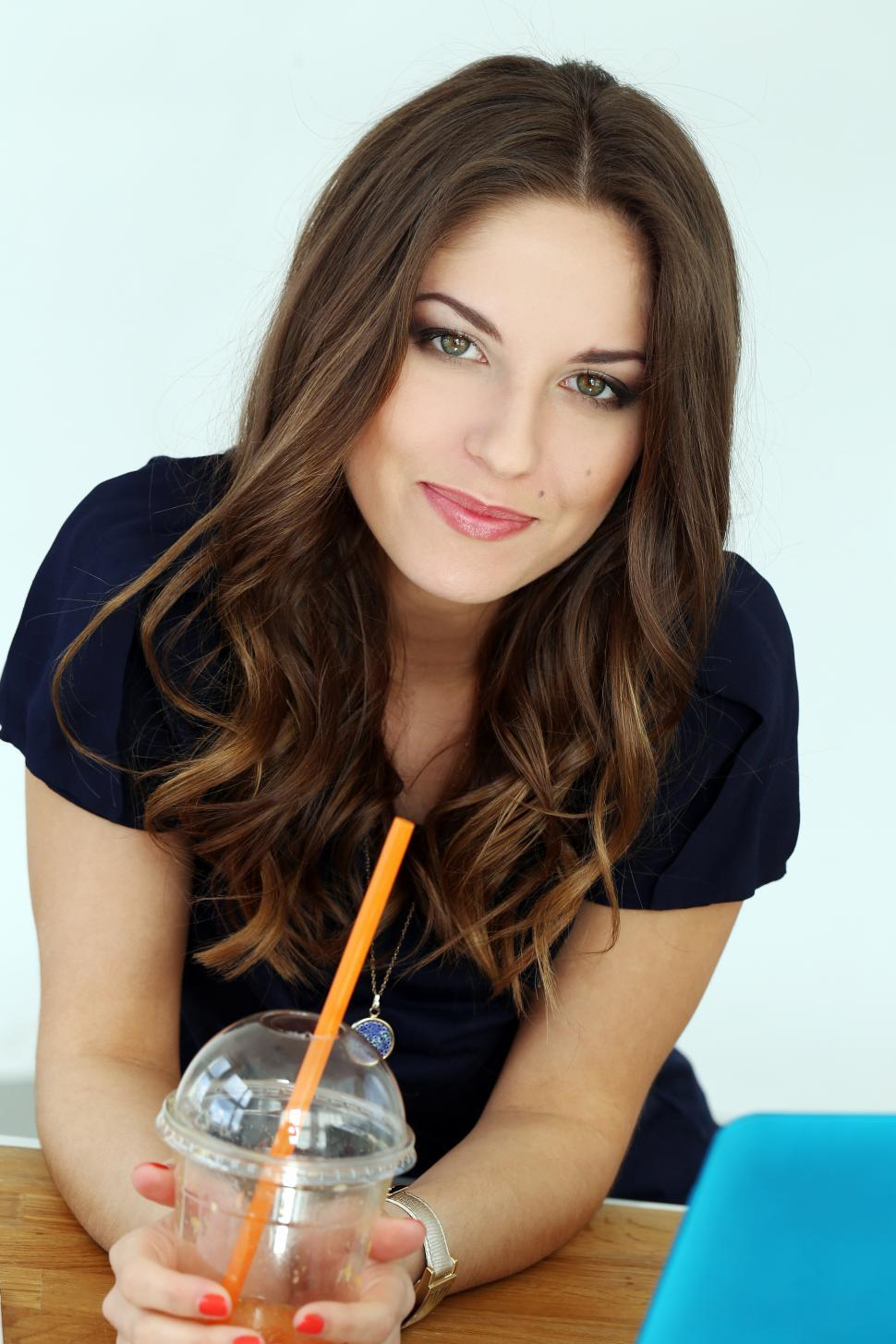 Download Free Stock HD Photo of Brunette woman looking at camera from work desk Online