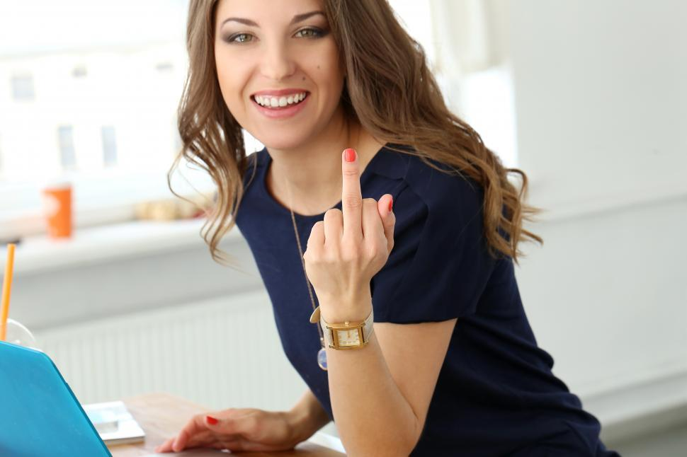Download Free Stock HD Photo of Girl showing middle finger Online
