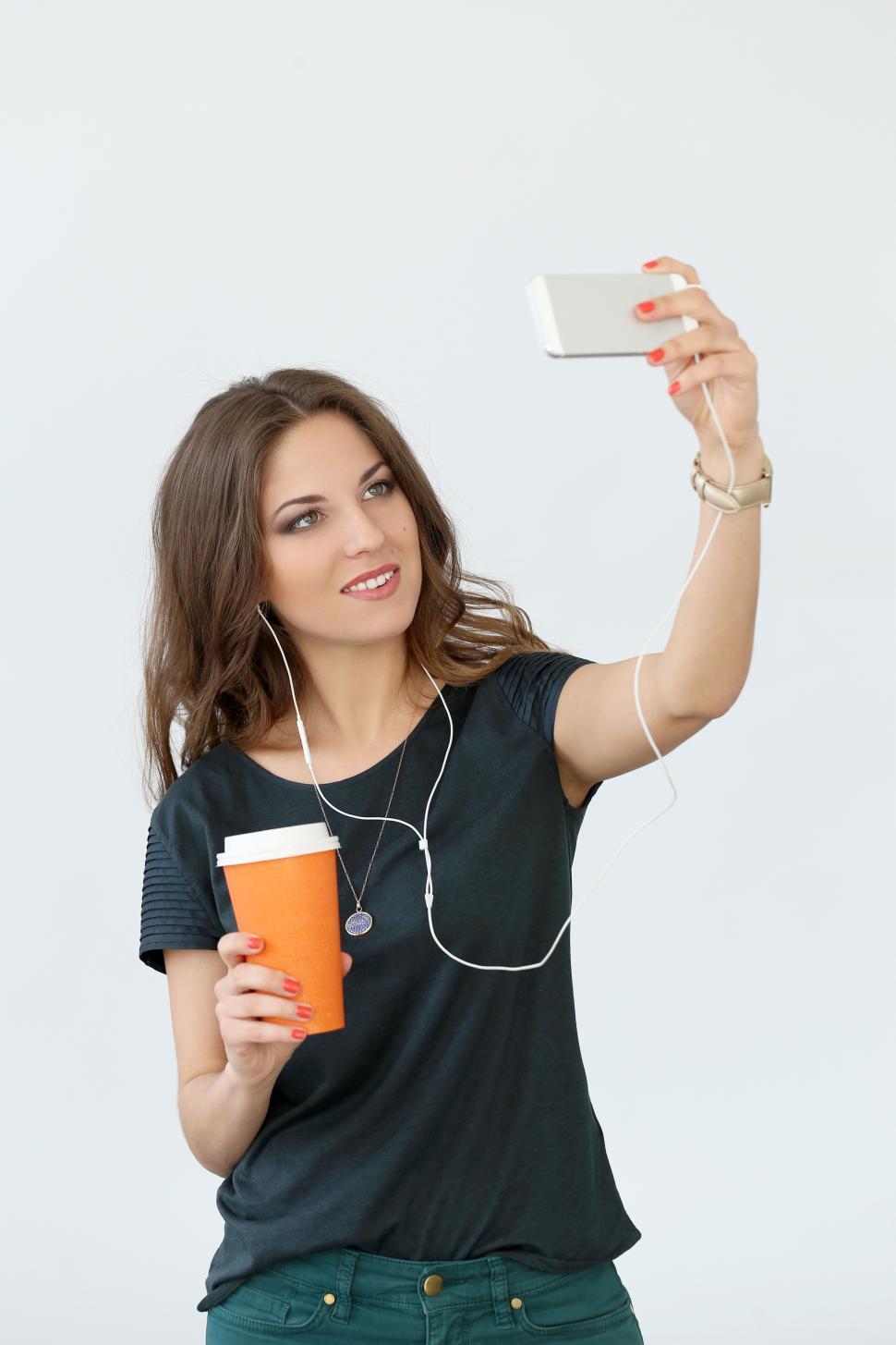 Download Free Stock HD Photo of Curly girl with mobile phone taking selfie Online