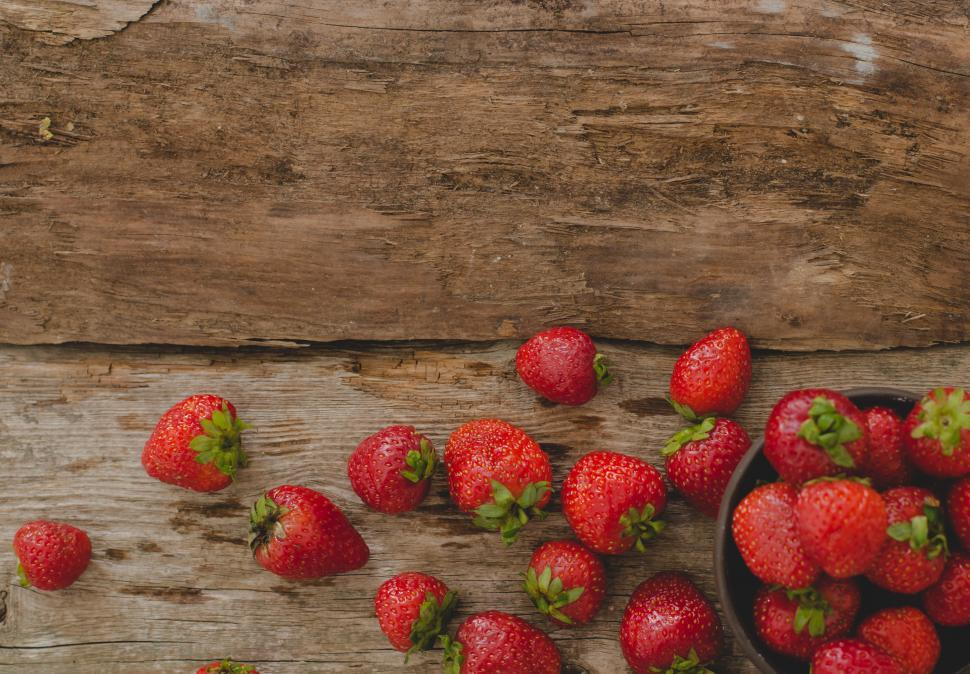 Download Free Stock HD Photo of Strawberries on the textured table Online