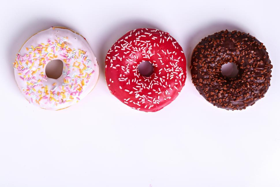 Download Free Stock HD Photo of Delicious donuts, all in a row Online