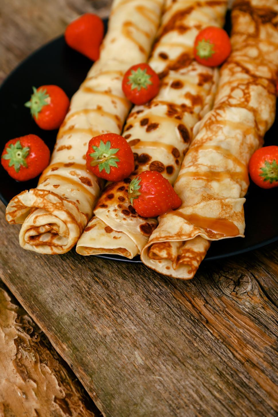 Download Free Stock HD Photo of Homemade pancakes - blinis rolled with fruit Online