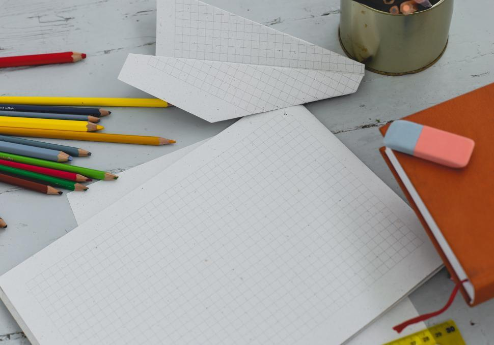 Download Free Stock Photo of Diary on the table with art supplies