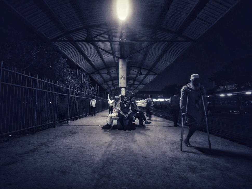 Download Free Stock Photo of Life between street beggar and working people Life between street beggar and working people