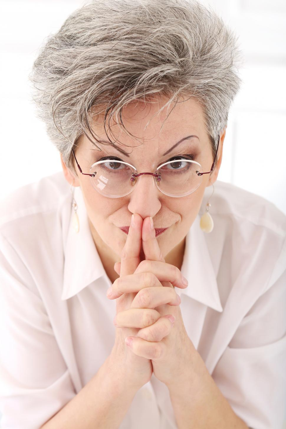 Download Free Stock Photo of Elderly woman looking thoughtful