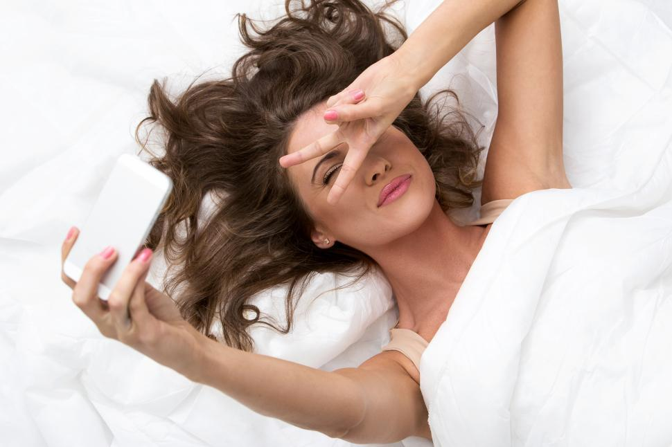 Download Free Stock Photo of Woman taking selfies in bed