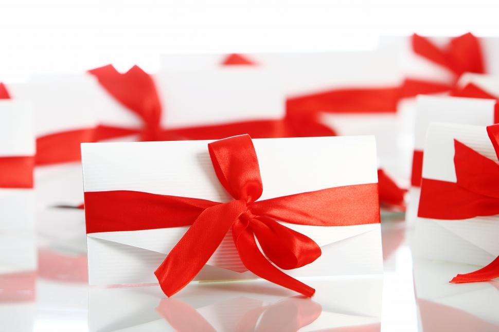 Download Free Stock HD Photo of Gift envelope with awesome red bow Online