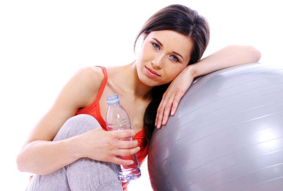Download Free Stock Photo of Young woman with bottle of mineral water
