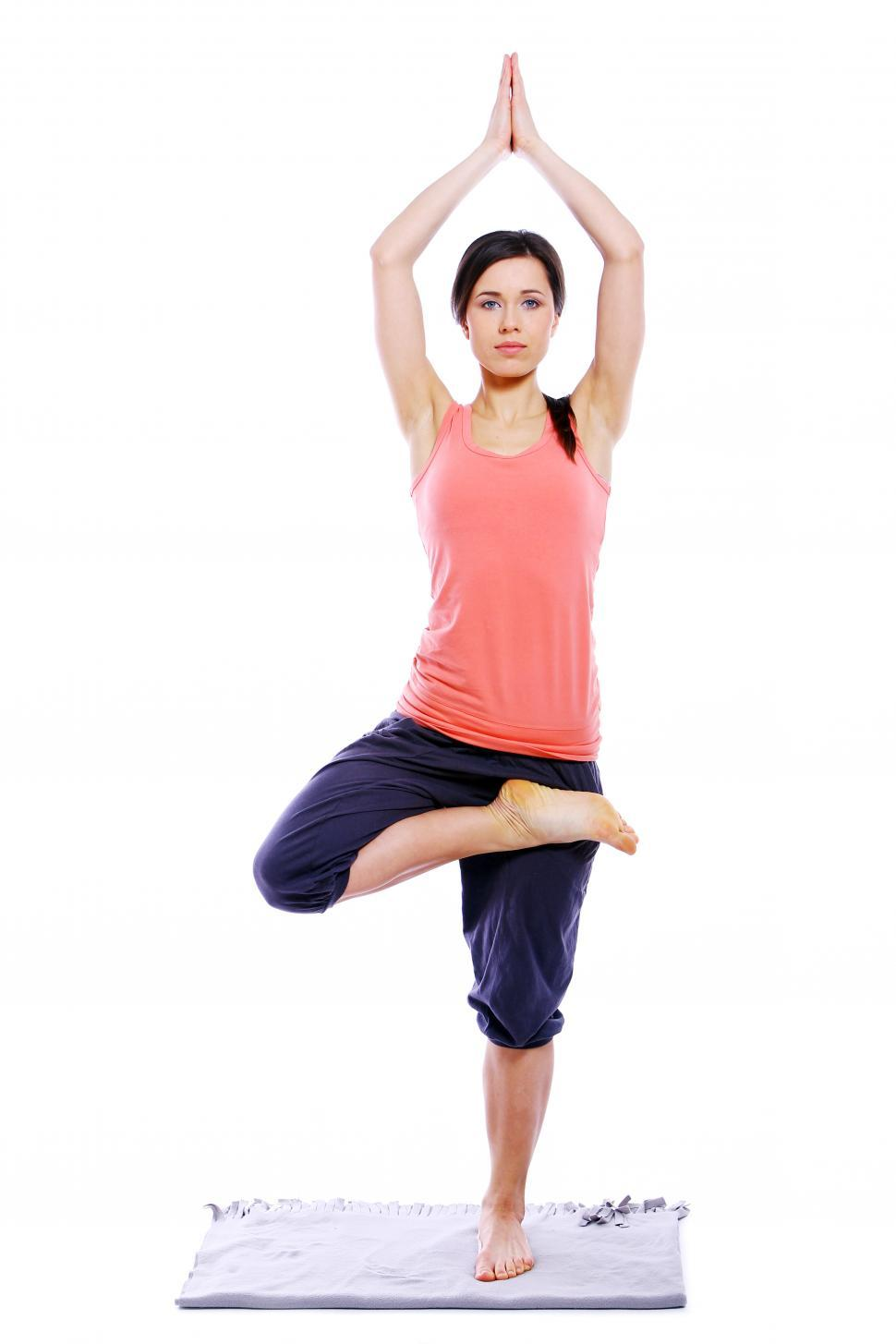 Download Free Stock Photo of Young and woman doing yoga - Tree Pose Half Lotus