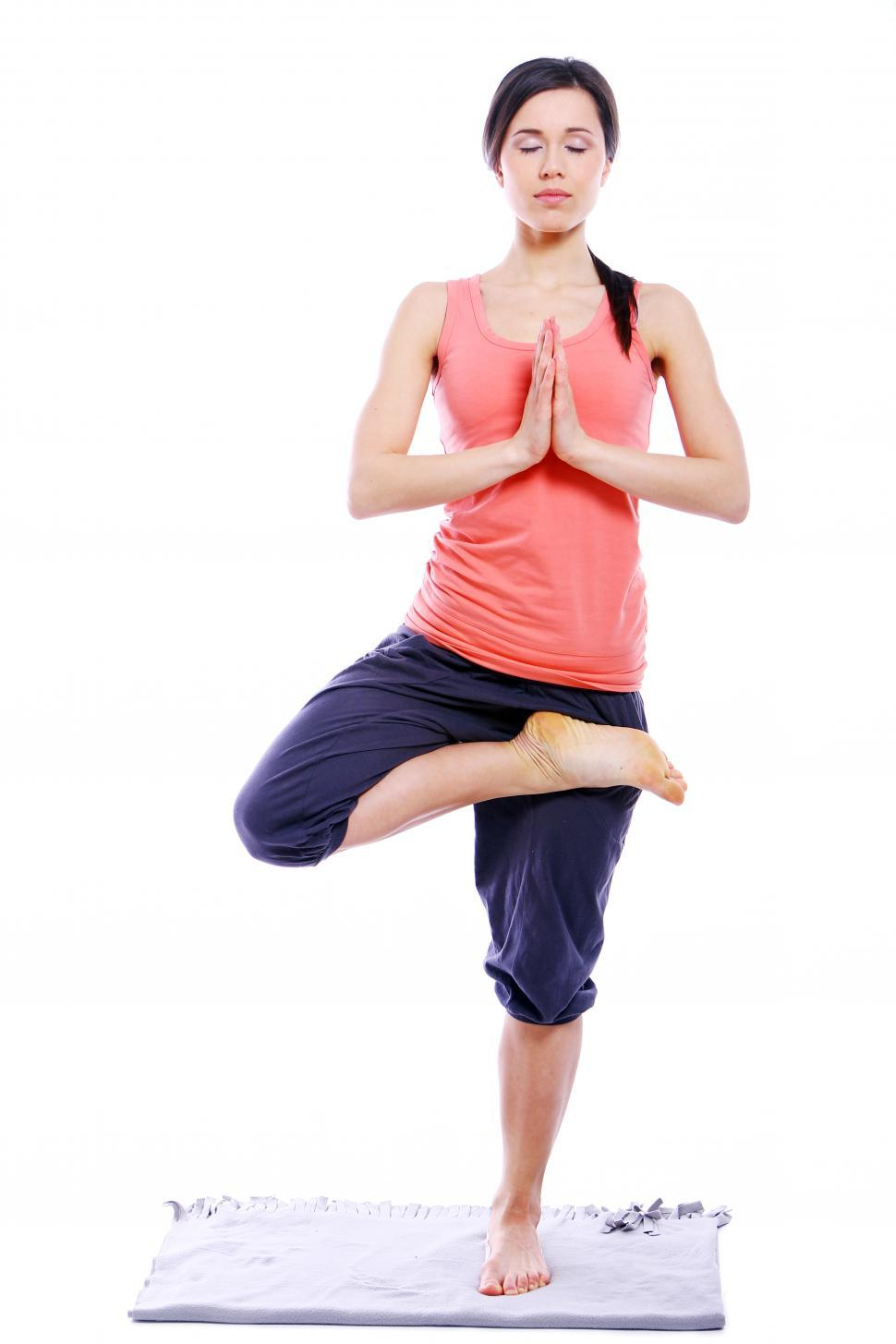 Download Free Stock HD Photo of Woman doing yoga - Tree Pose Hands in Prayer Position Online