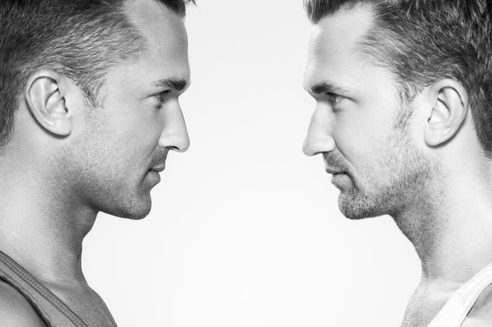 Download Free Stock HD Photo of Handsome guys facing each other, black and white Online