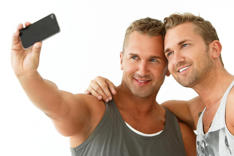 Download Free Stock HD Photo of Handsome guys at home taking a selfie Online
