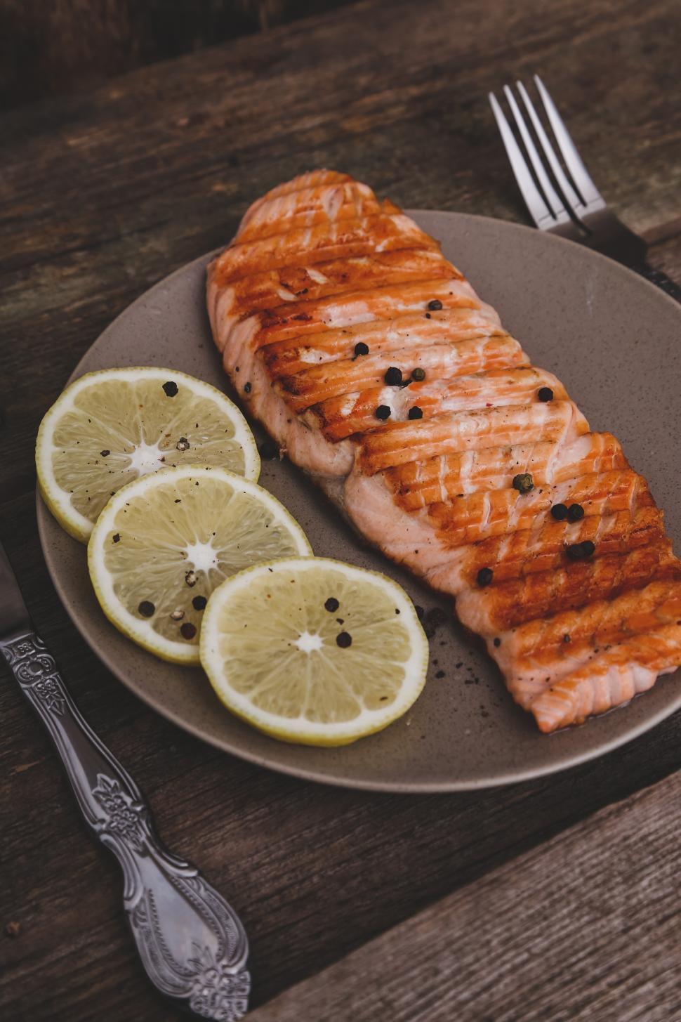 Download Free Stock HD Photo of Meal of grilled salmon with lemon Online