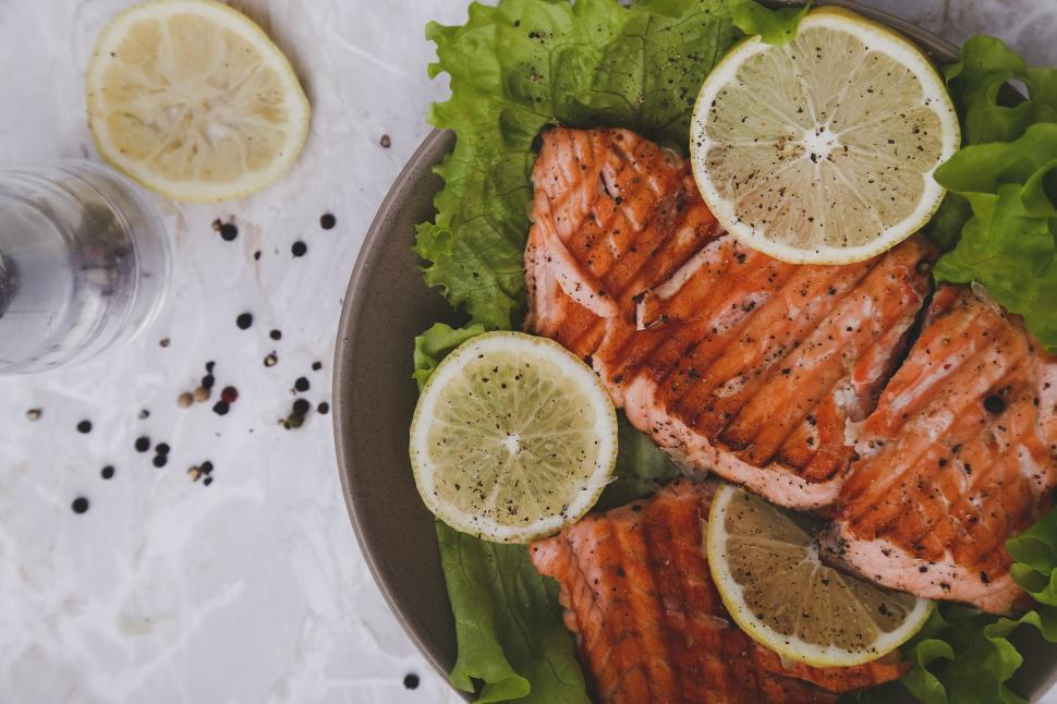 Download Free Stock Photo of Plate of grilled salmon with lemon