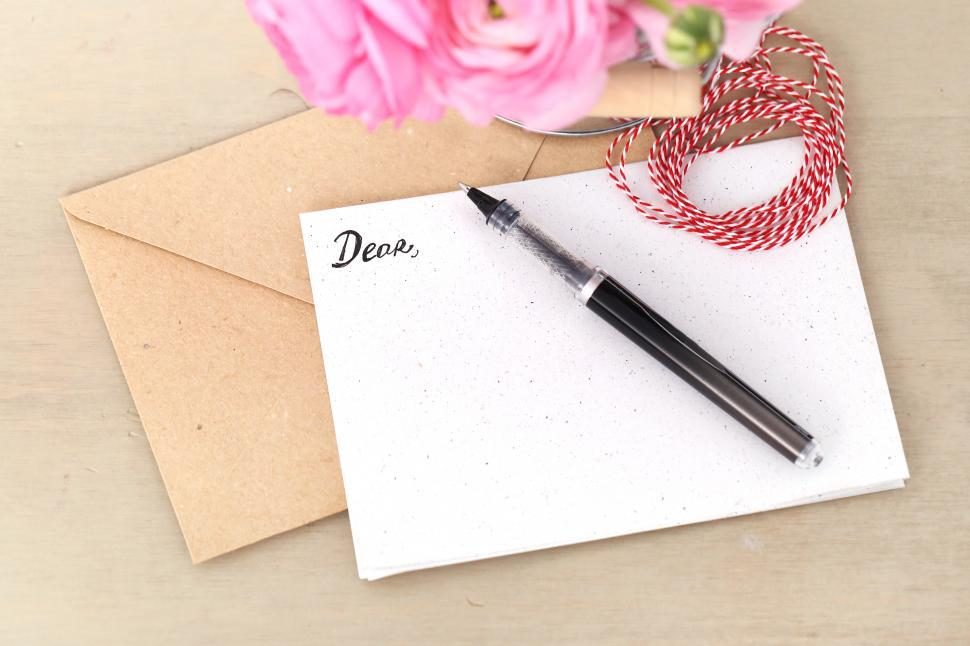 Download Free Stock HD Photo of Stationary with pen and flowers Online