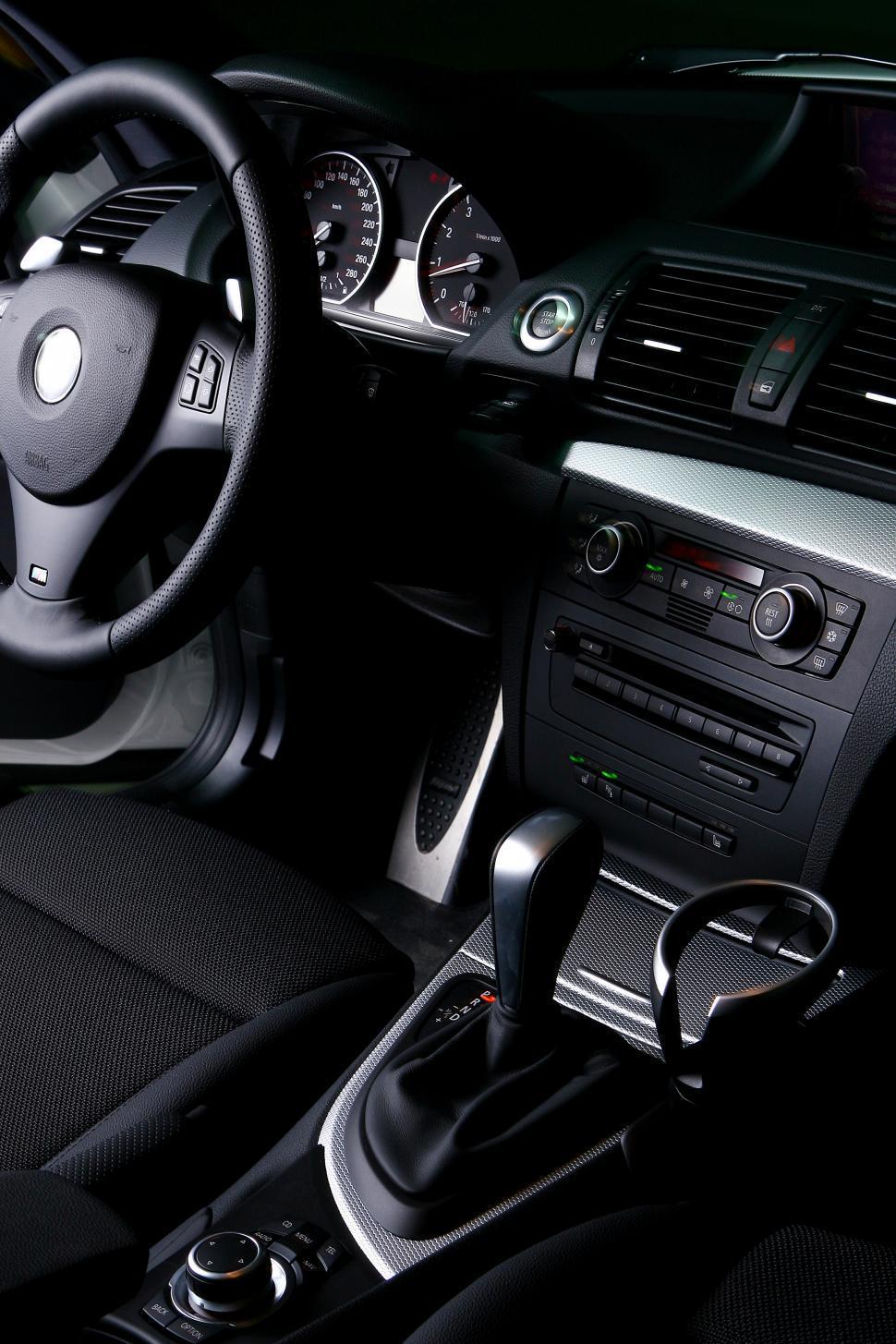 Download Free Stock Photo of plush car interior in black