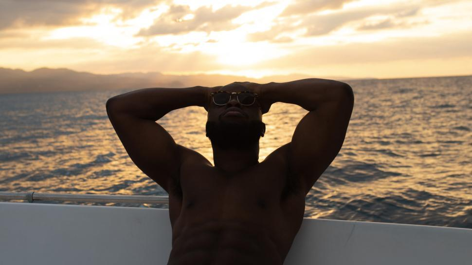 Download Free Stock Photo of Young Shirtless Man Relaxing on Yacht