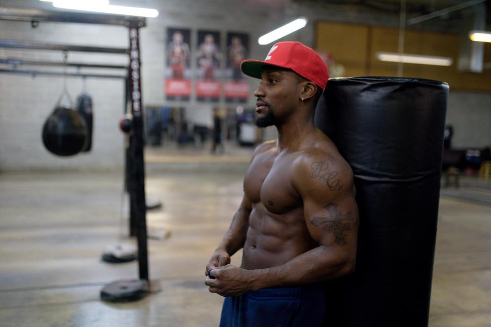 Download Free Stock Photo of Young Male Bodybuilder in red cap