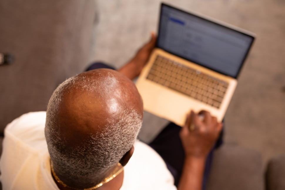 Download Free Stock Photo of Older Man working on laptop at home