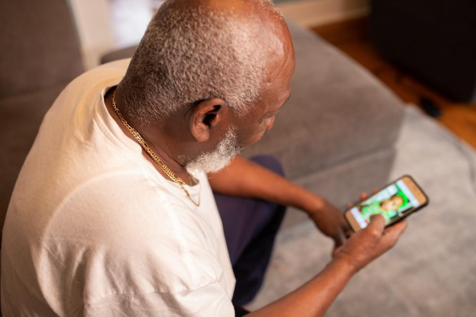Download Free Stock Photo of Older Man with smart Mobile phone at home