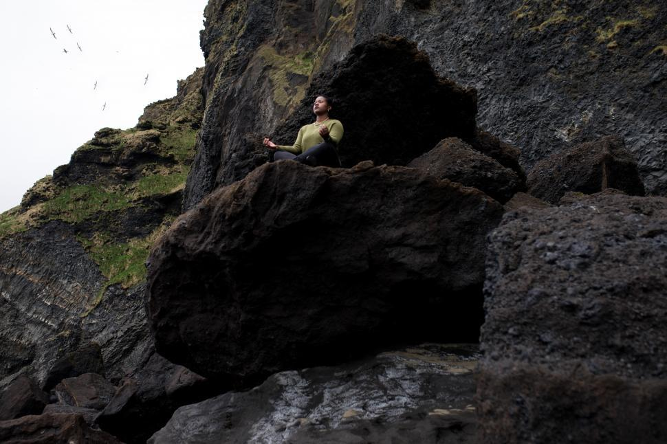 Download Free Stock Photo of Young Woman meditating on mountain