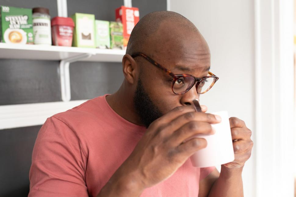 Download Free Stock Photo of Young Man in Spectacles Holding a Coffee Mug