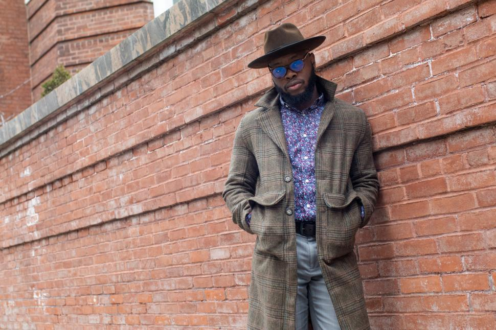 Download Free Stock Photo of Young Stylish man in tweed overcoat with hands in pockets