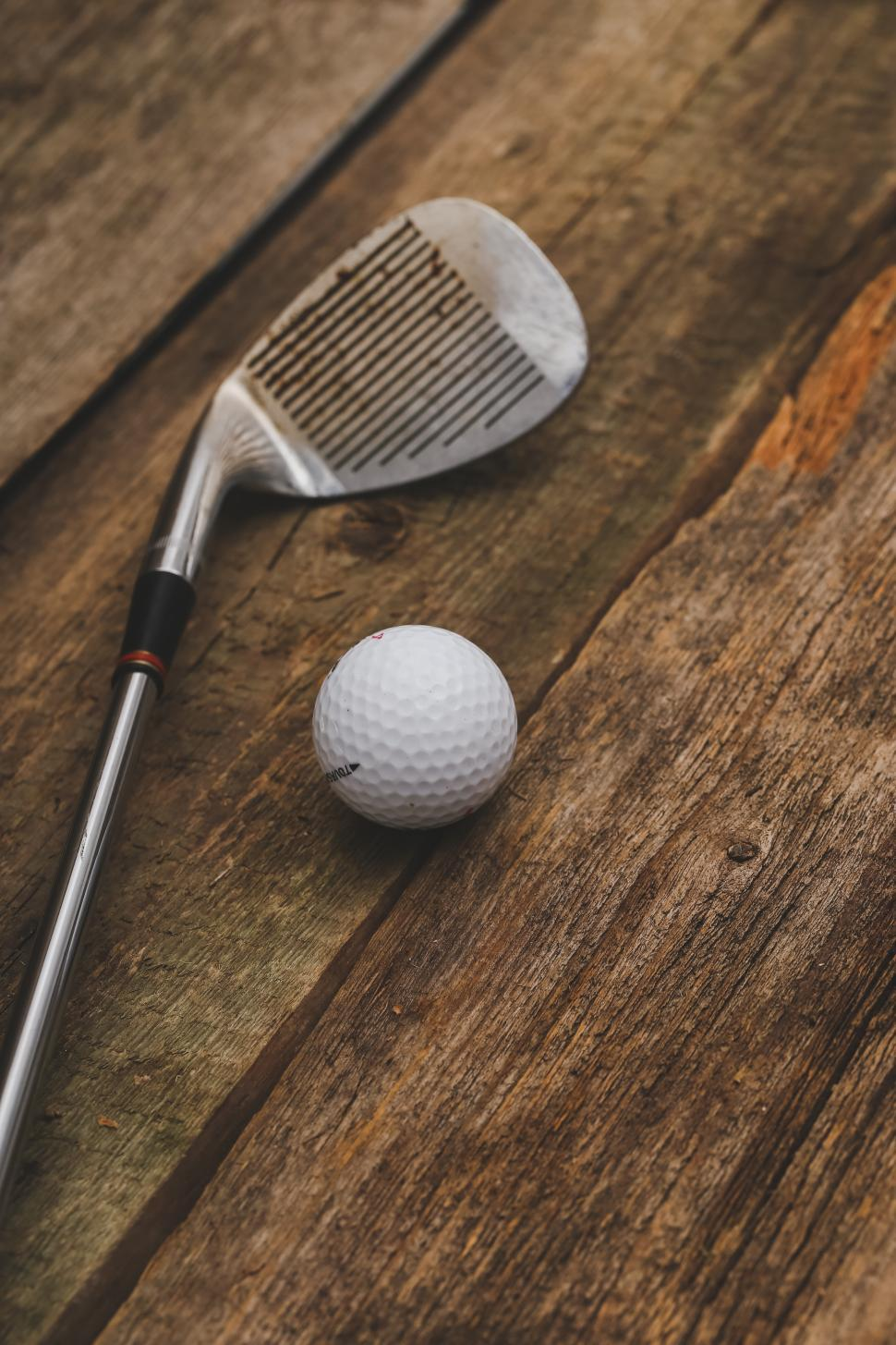 Download Free Stock Photo of Golf club and ball on textured background