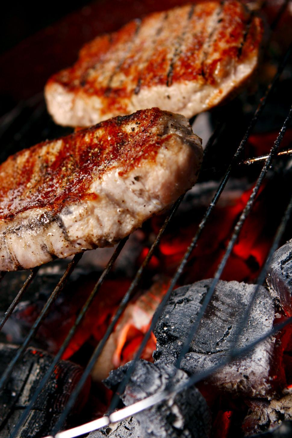 Download Free Stock Photo of a fresh grilled steak over hot coals