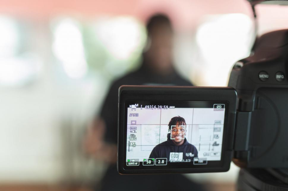 Download Free Stock Photo of Young Man Vlogging With DSLR Camera