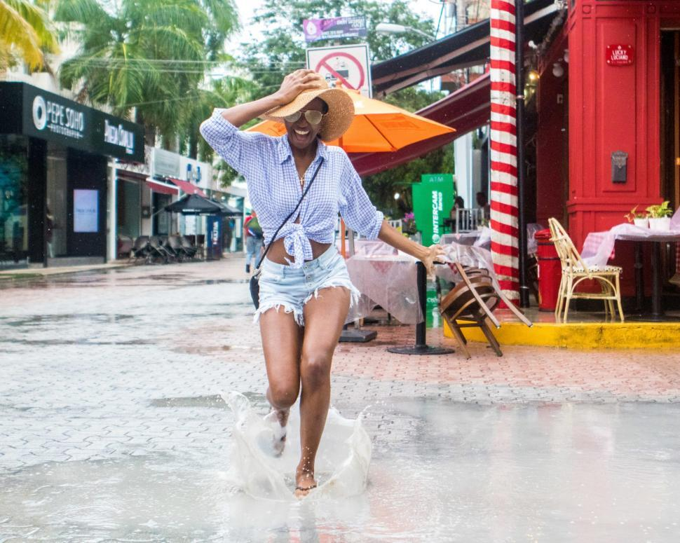 Download Free Stock Photo of Young Woman in Denim Shorts and sling bag in the rain
