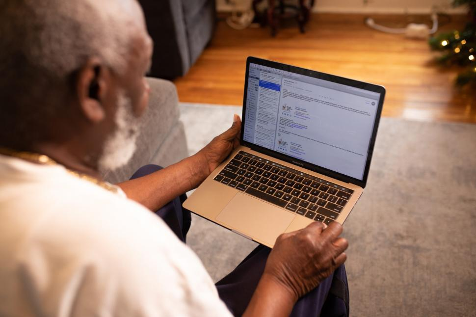 Download Free Stock Photo of Man working on laptop at home in living room