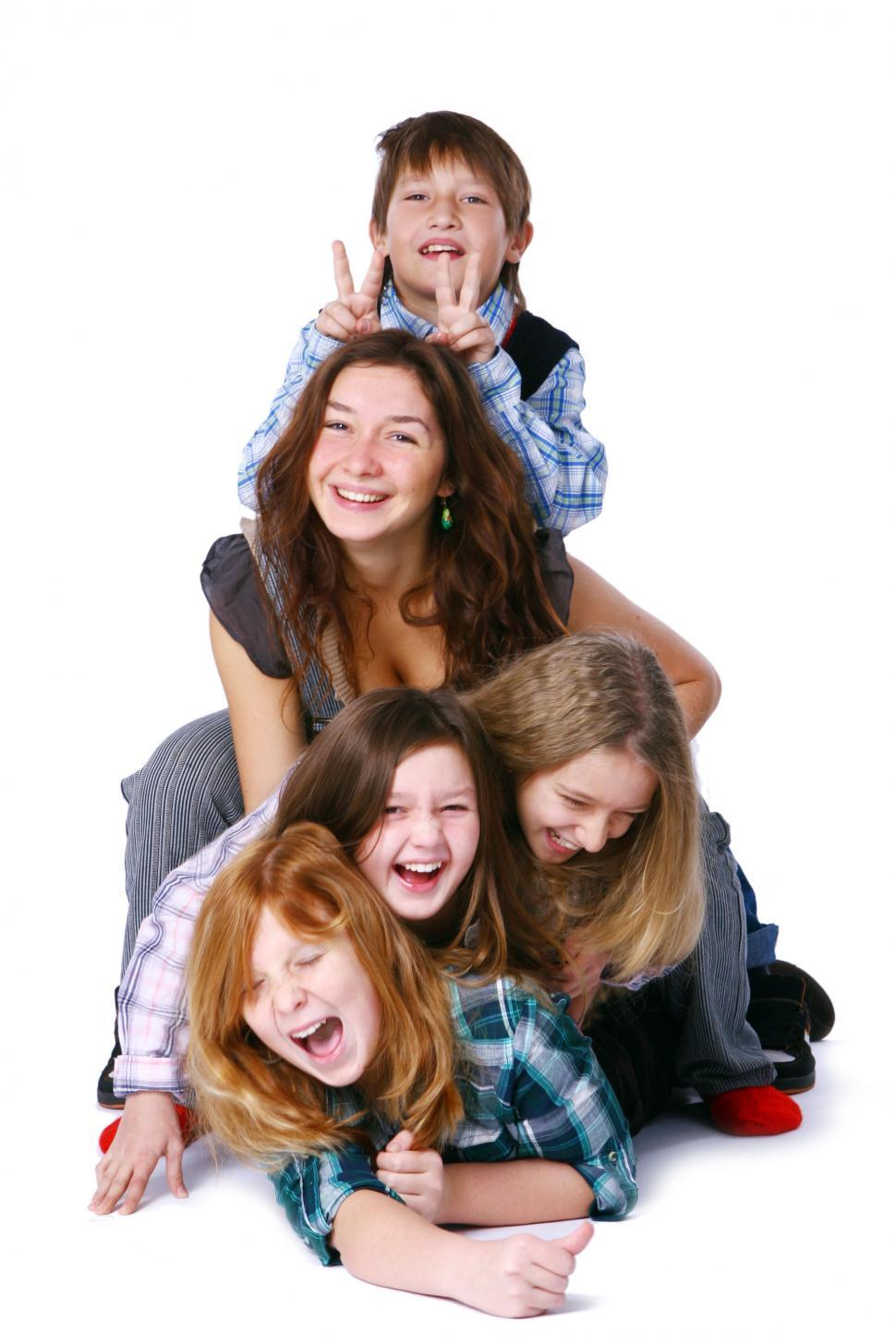 Download Free Stock Photo of Pile of cute and happy kids posing on white background