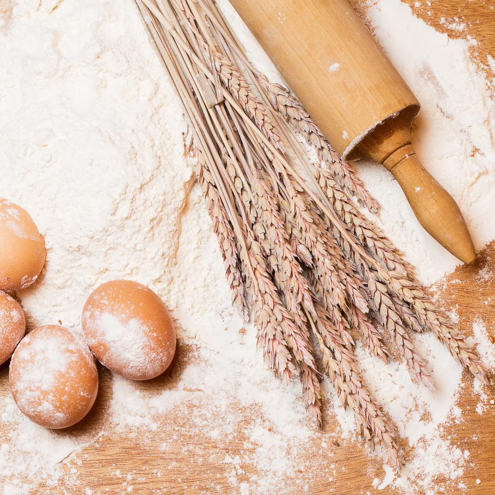 Download Free Stock Photo of Cooking. Rolling pin and eggs in the flour