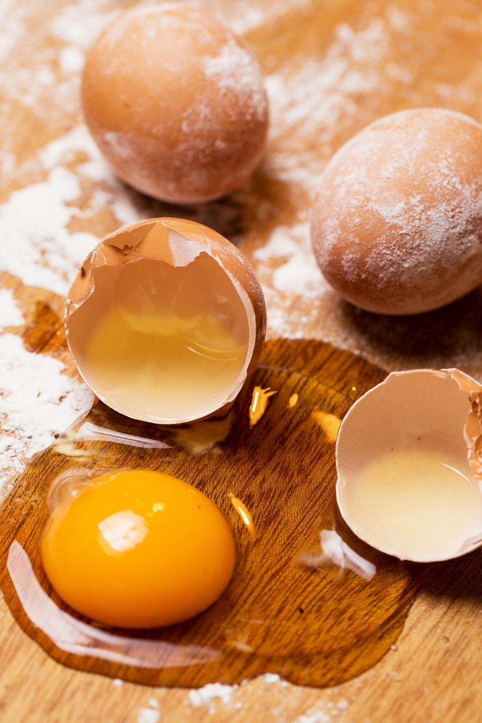 Download Free Stock Photo of Cooking, close-up. Bunch of eggs in the flour