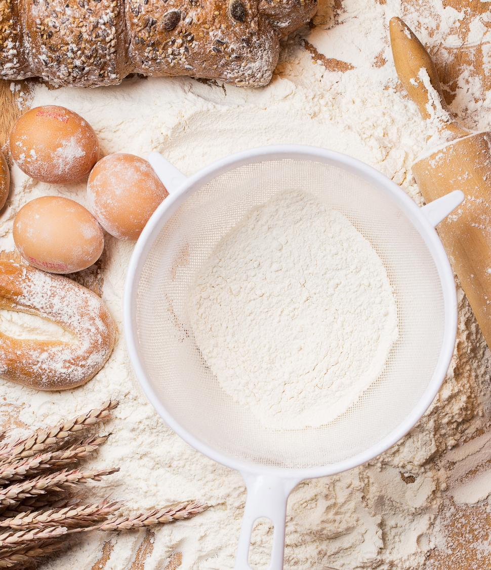 Download Free Stock Photo of Cooking. White sieve with flour and bread
