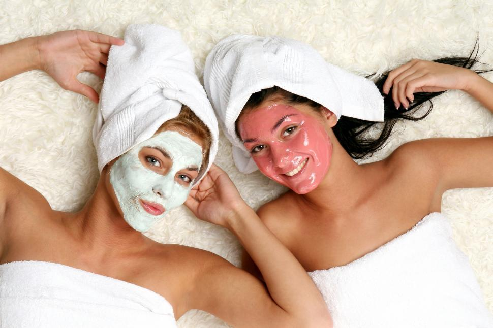 Download Free Stock Photo of Two women with spa facial treatment
