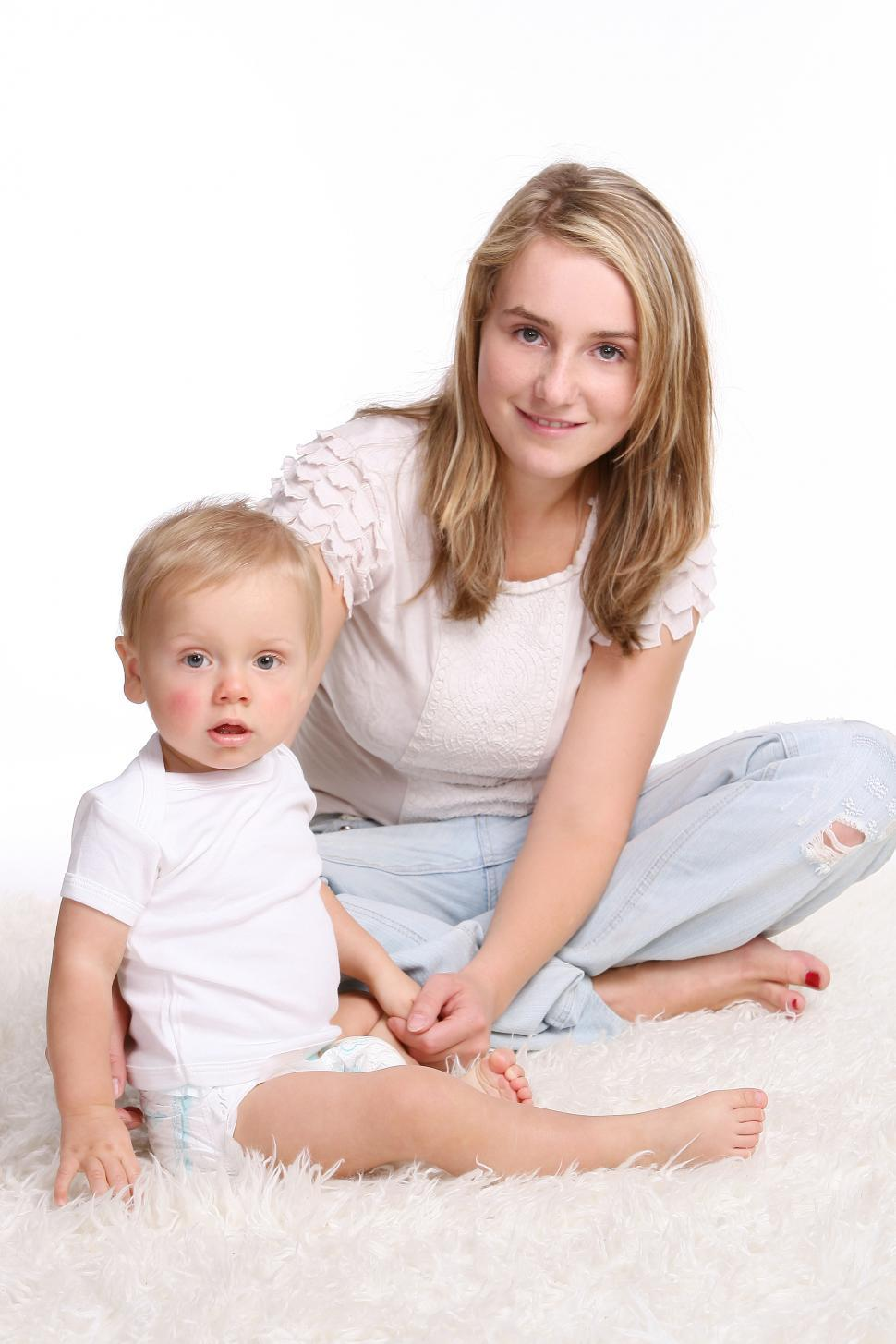 Download Free Stock Photo of a young mother with kid