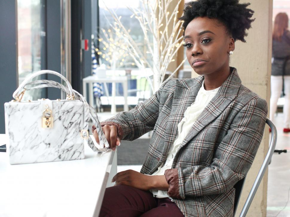 Download Free Stock Photo of Young business woman in tweed blazer - looking thoughtful