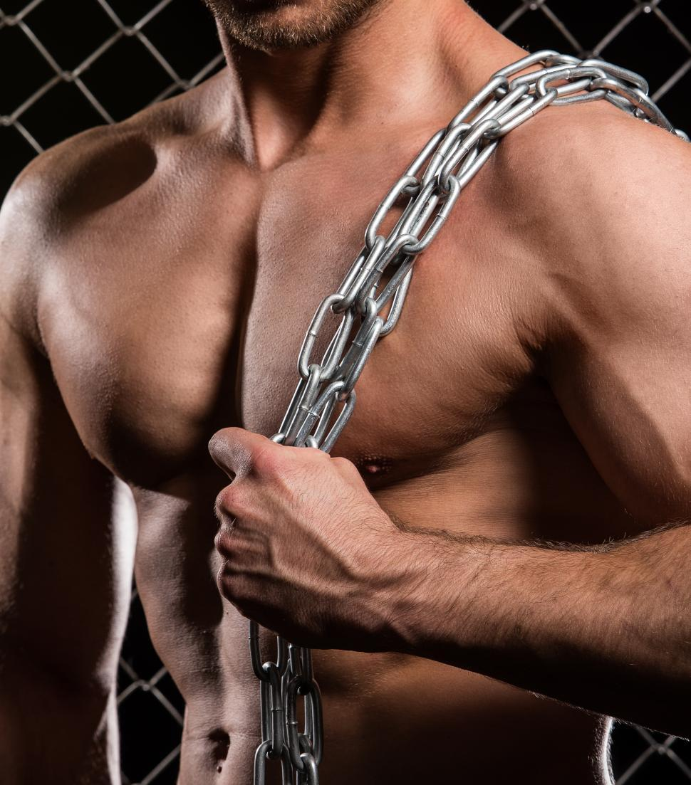 Download Free Stock Photo of Fitness. Shirtless muscular man with chains over shoulder