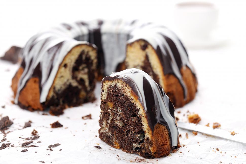 Download Free Stock Photo of Delicious bundt cake, frosted and sliced